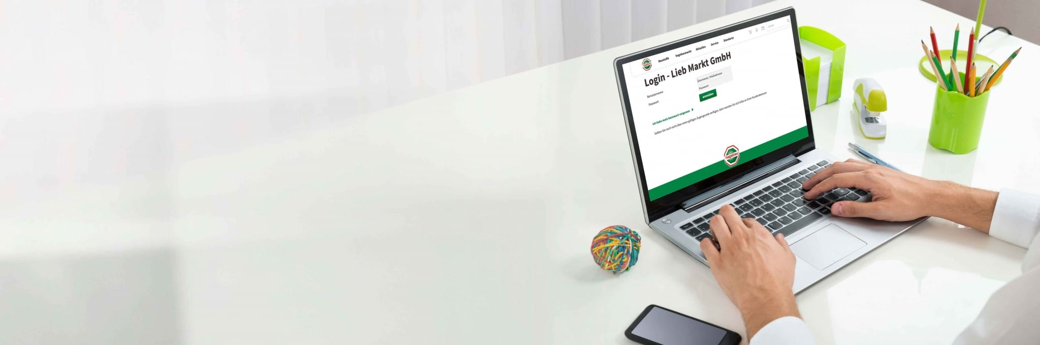 Log-in Bildschirm für das Lieb Markt Gewerbeportal auf dem Laptop.